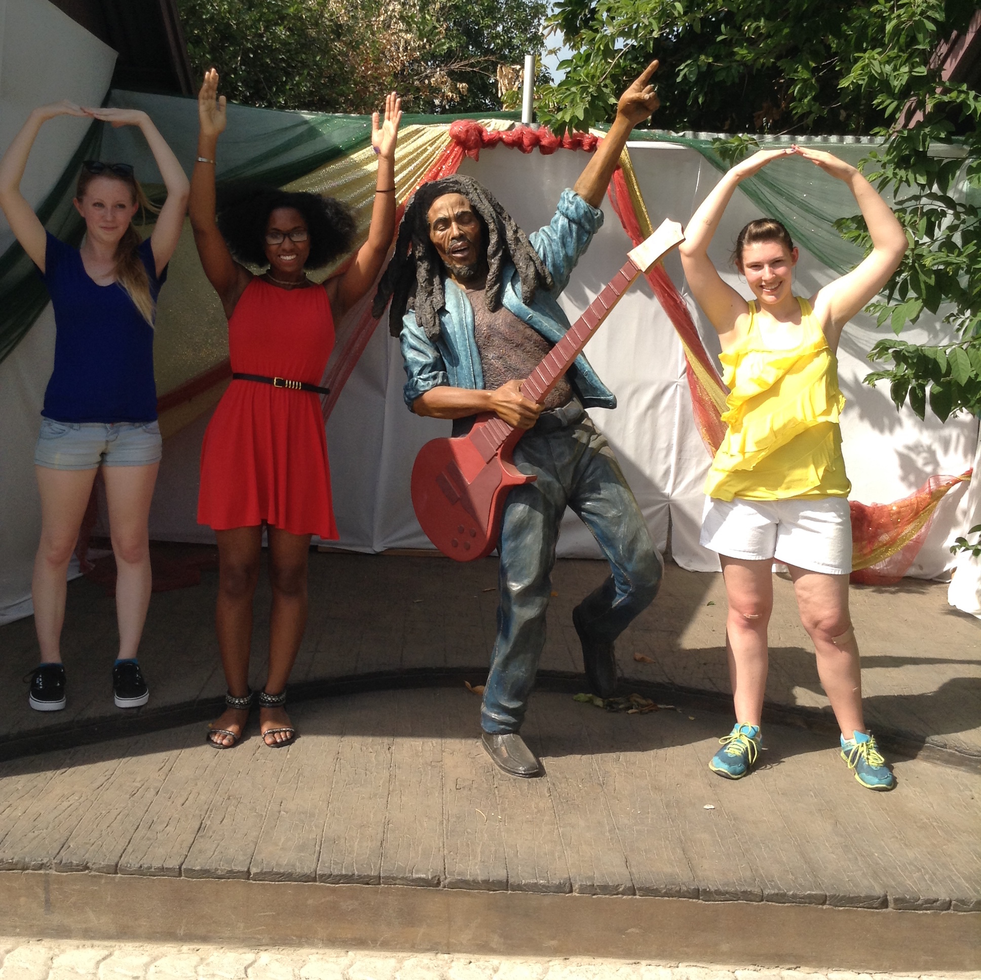 Students pose with a statue of Bob Marley in Jamaica