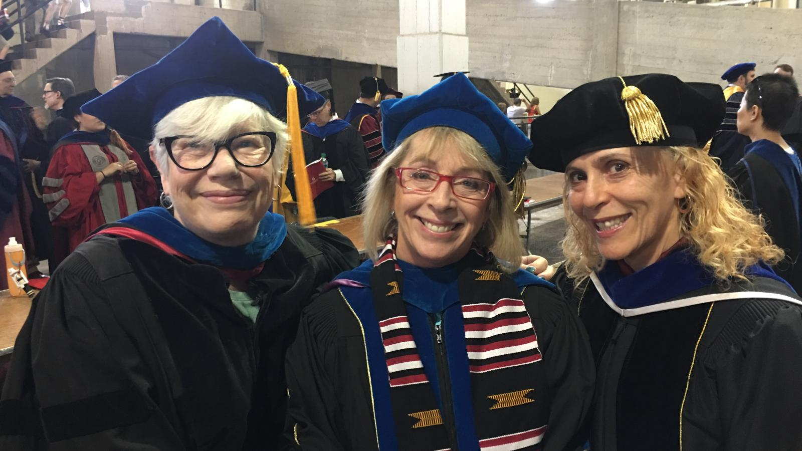 Dr.'s Smith-Shank, Ballengee Morris, and Goldberg-Miller (left to right) prepare to hood soon to be PhD alumni