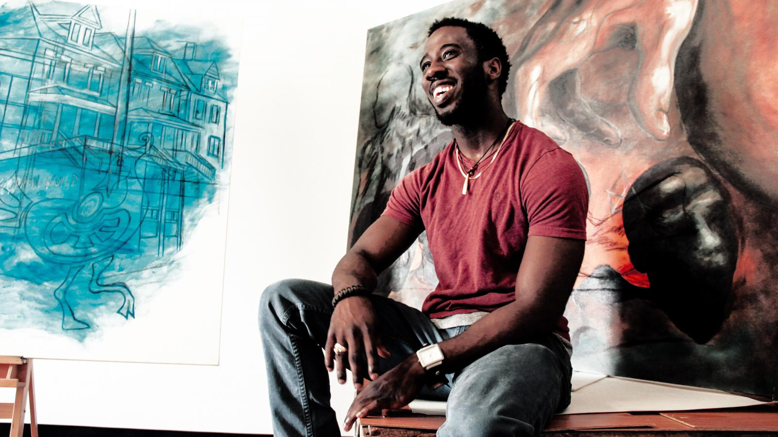 Omar Clarke with artwork in his studio