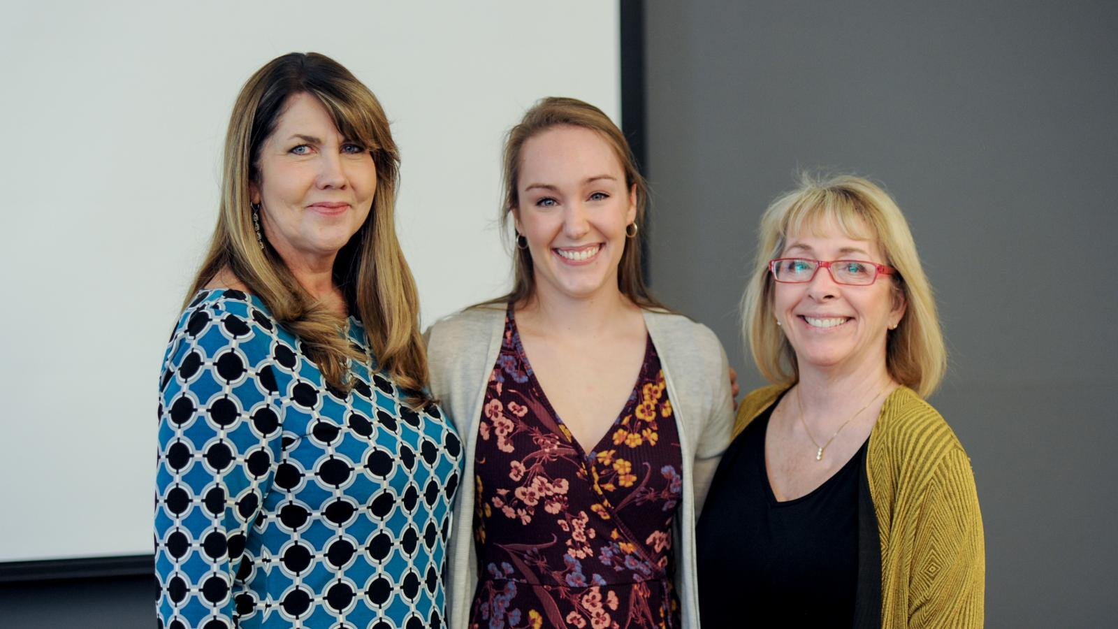 2018 AAEP Outstanding GTA and Graduate Associate Teaching Award winner Elle Pierman (center) with course advisors Dr. Shari Savage (left) and Dr. Christine Ballengee Morris (right)